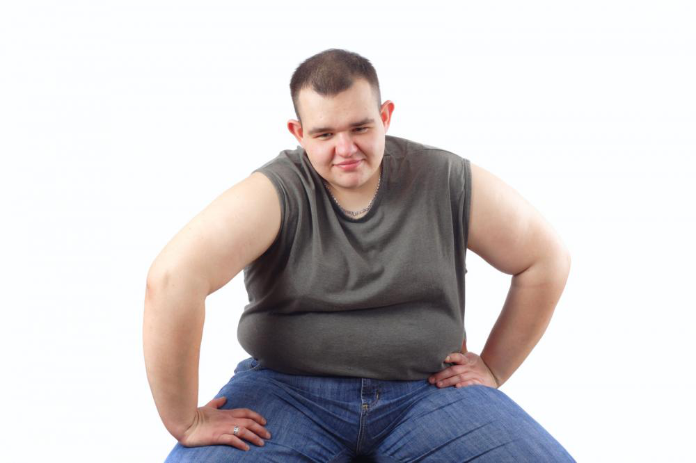 Obese man struggling to get up.