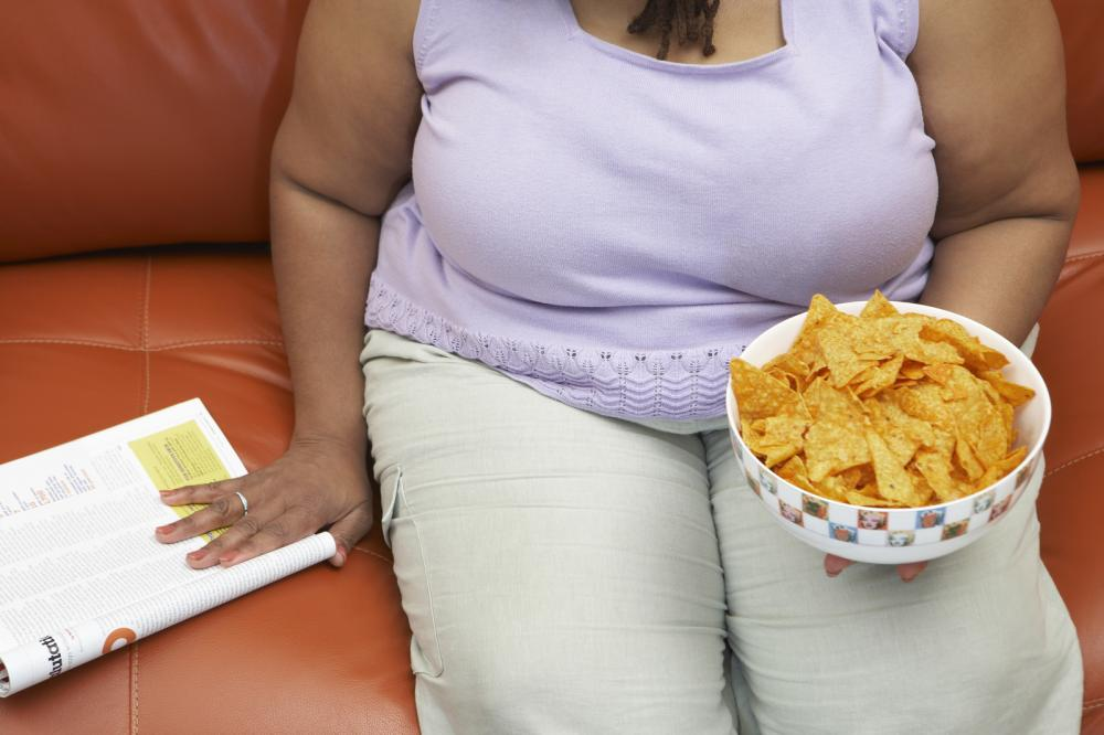 Obese woman sitting on a couch.