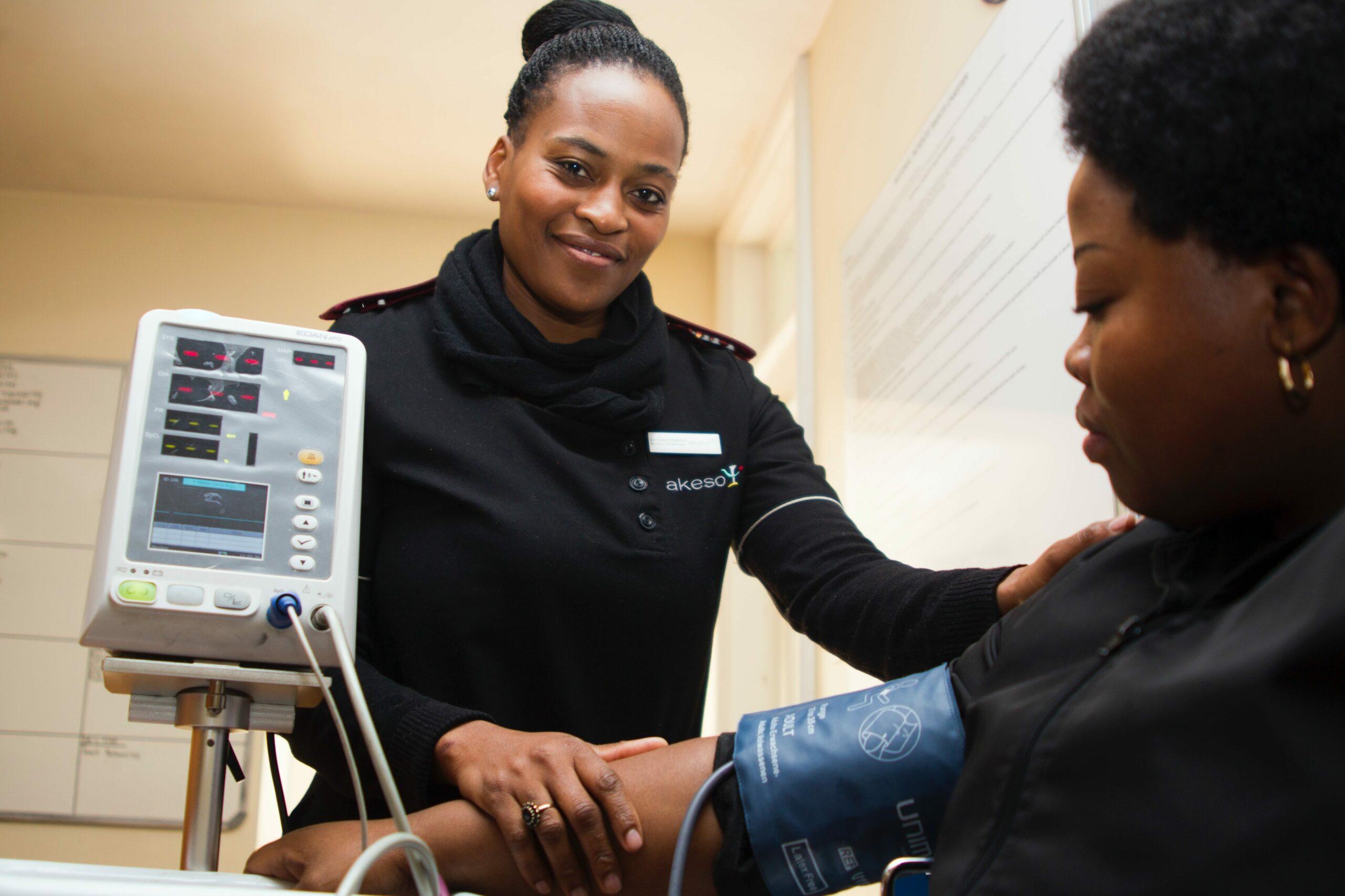 Nurse taking blood pressure overweight patient