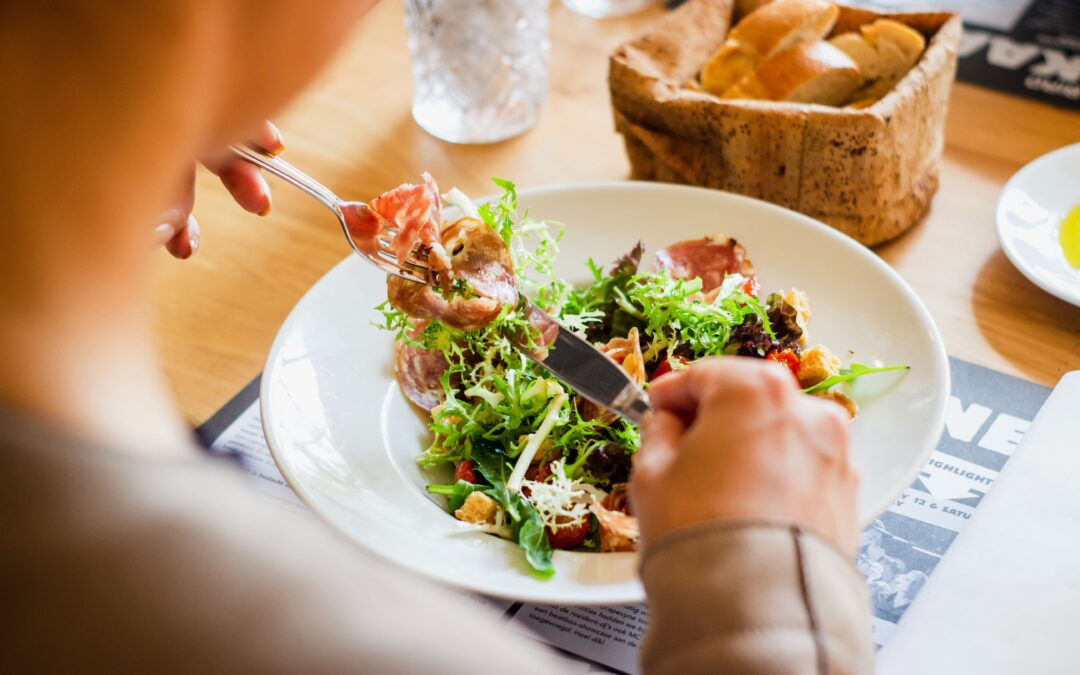 man eating a salad as part of his new diet