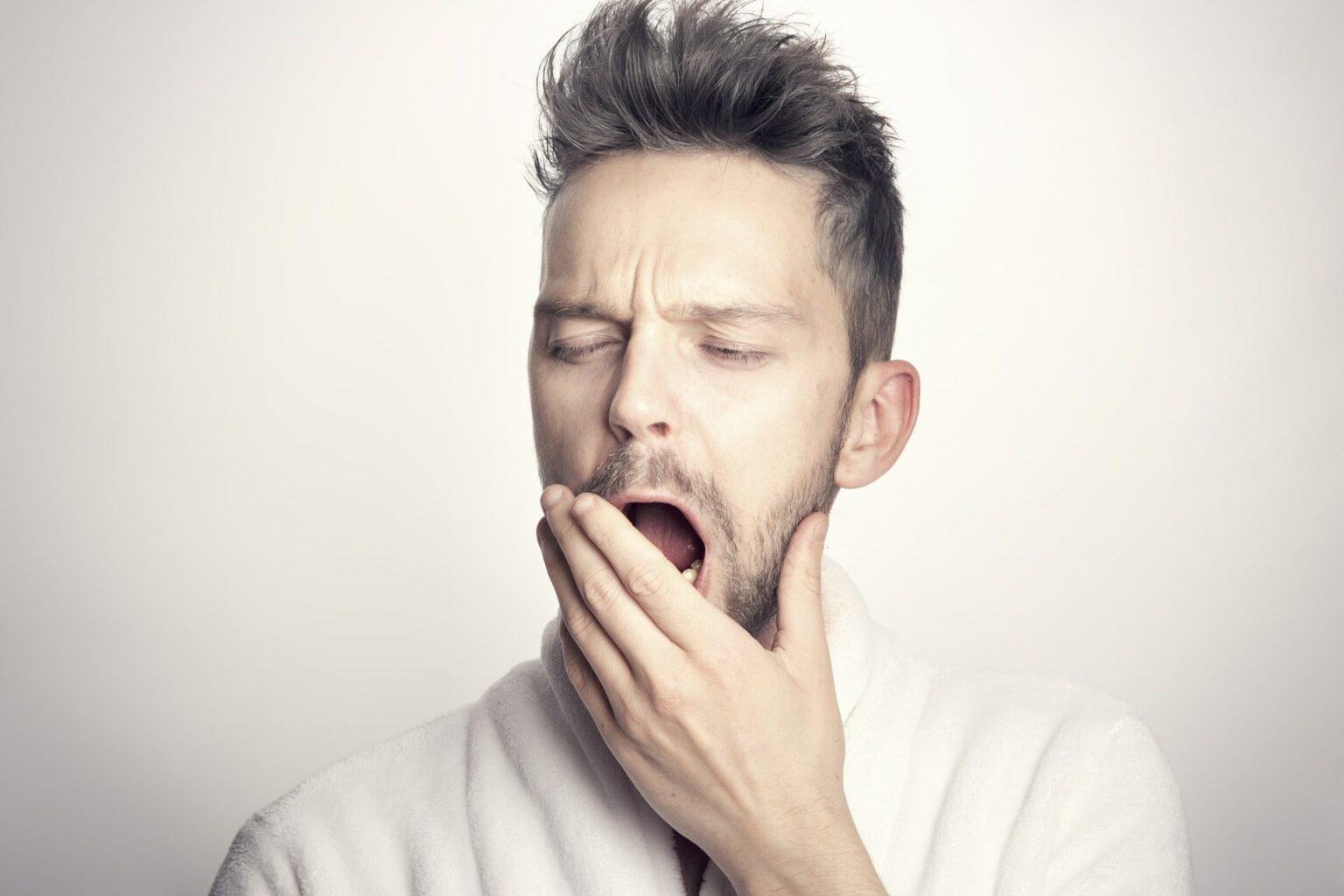 man yawning because he's tired