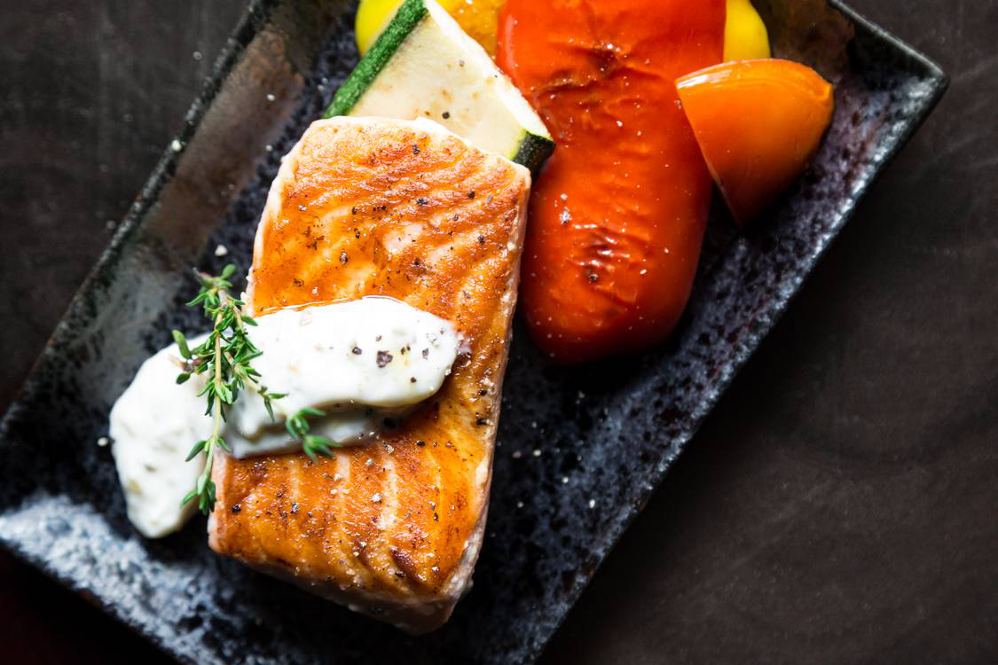 Grilled salmon on a ceramic plate