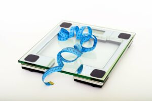 weighing scale representing weight loss