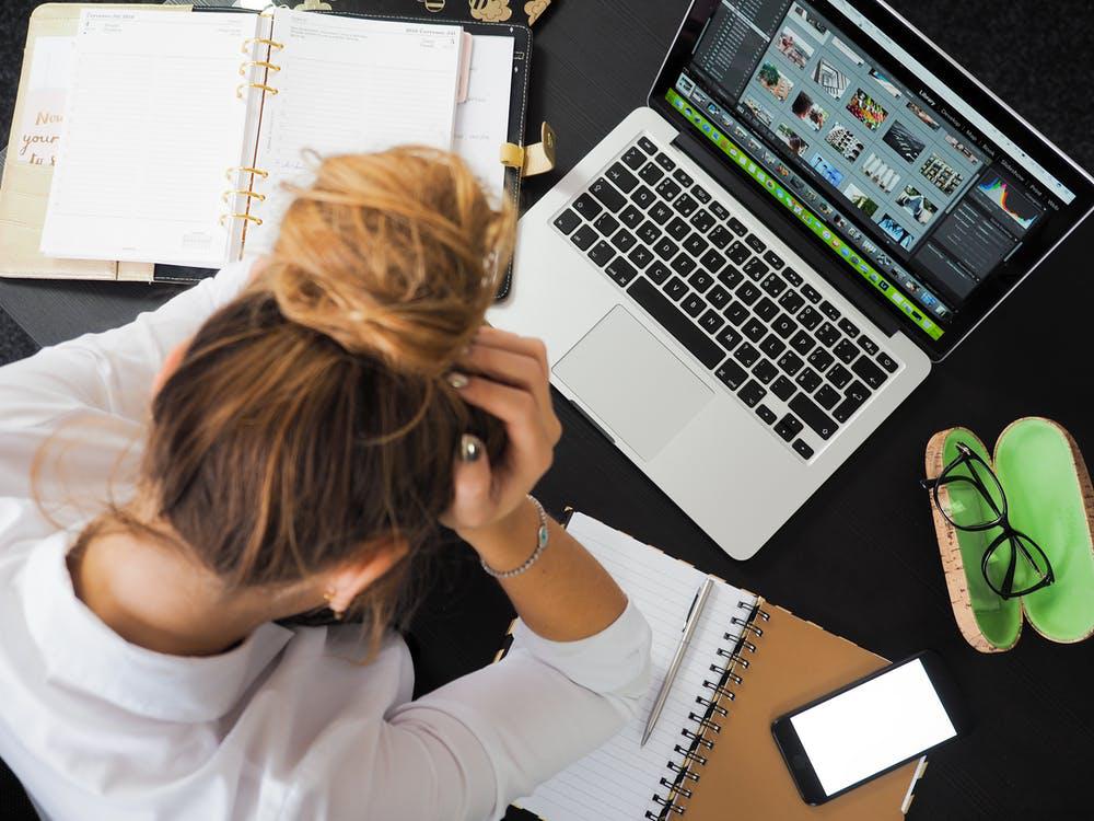 Overworked employee trying to meet deadlines.