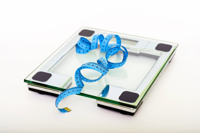 Weighing scale and tape measure to monitor weight loss.