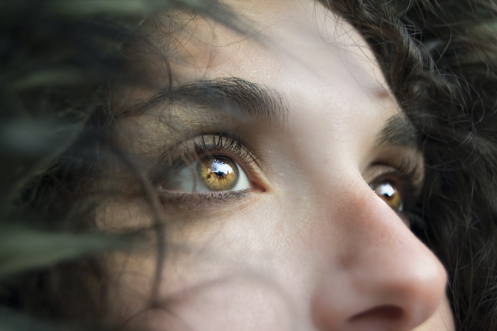 woman staring with yellow eyes